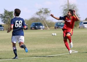 Grande Sports Academy's Sebastian Saucedo celebrates goal as he helps RSL-AZ soccer academy to  a 7-2 win.
