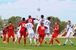 Real Salt Lake - Arizona soccer team heading the ball against the LA Gaxaly